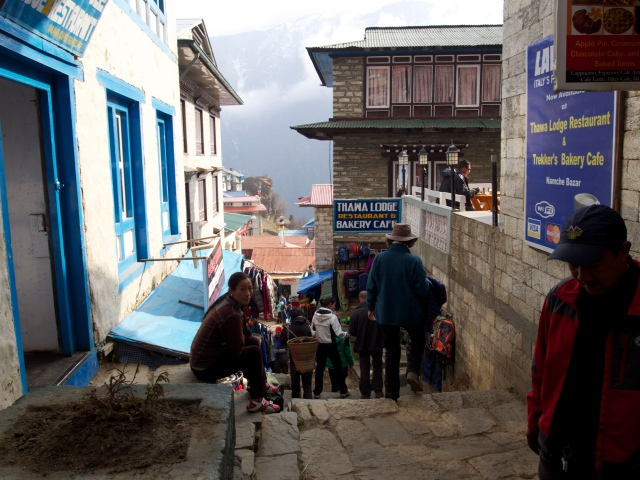 The main street in downtown Namche bustles with